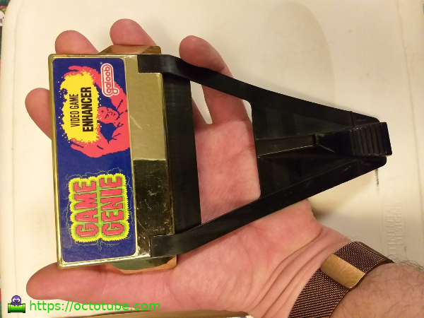 Game Genie in hand